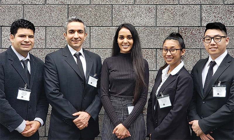 cal state fullerton students posing for picture at cybersecurity event