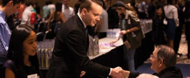 Cal State Student Brian Ruef shakes hands with event attendee