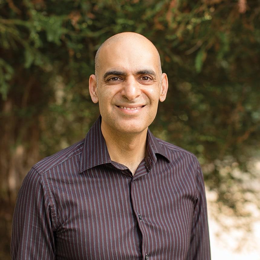 Headshot photo of Professor Atul Teckchandani