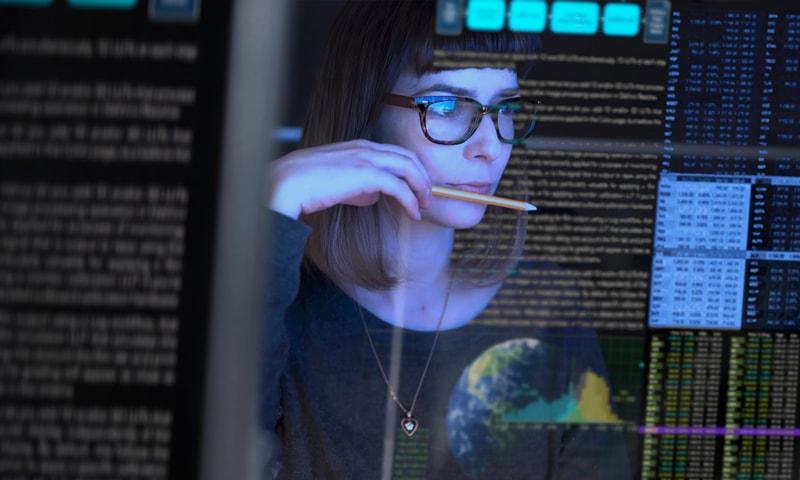 Stock image of woman at computer screen